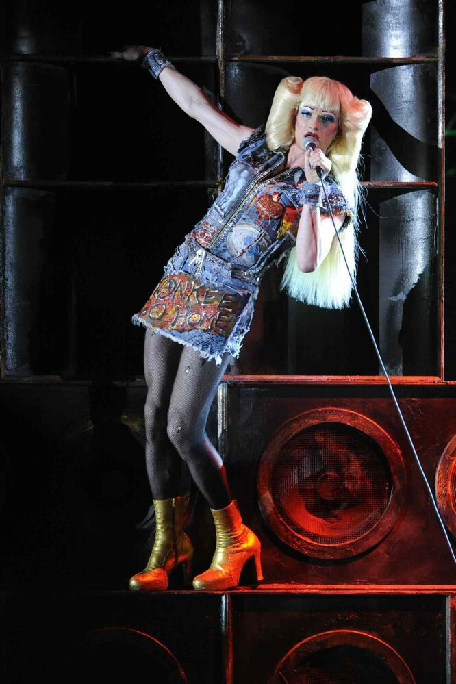 "Neil Patrick Harris and the cast of ""Hedwig and the Angry Inch"" perform.  The production won four Tonys.  Harris won in the best performance by an actor in a leading role in a musical category.   (Evan Agostini / The Associated Press)"