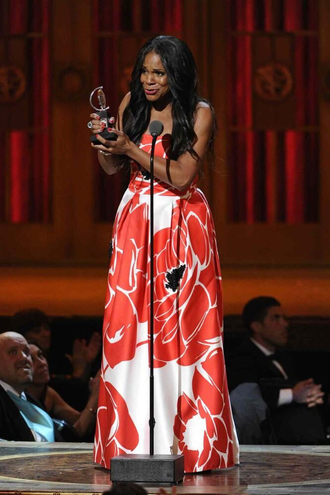 "Audra McDonald accepts the award for best performance by an actress in a leading role in a play for ""Lady Day at Emerson's Bar & Grill"". (Evan Agostini / The Associated Press)"