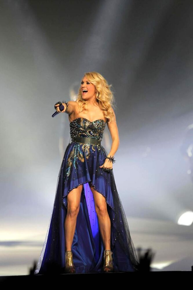 Carrie Underwood points into the crowd.