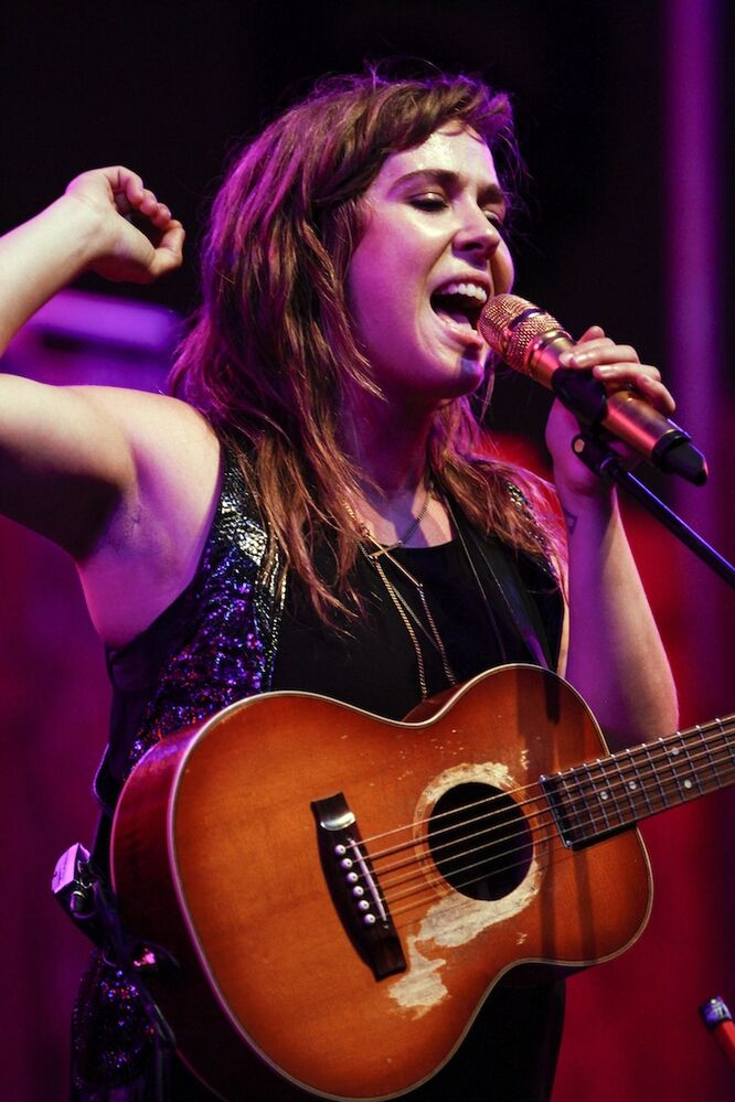 Ryder belts out one of her songs, brandishing a rather small acoustic guitar. (JESSICA BURTNICK / WINNIPEG FREE PRESS)