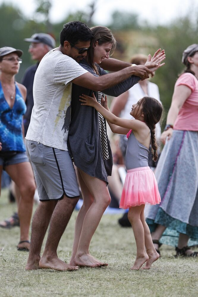 A family dances together at the Big Blue stage. (JESSICA BURTNICK / WINNIPEG FREE PRESS)