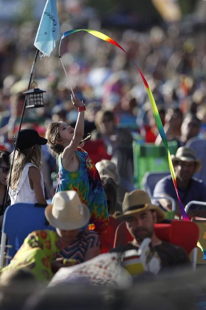 SUNDAY, JULY 14 — The festival was full of colours, like those on this girl's ribbon. (John Woods / Winnipeg Free Press)