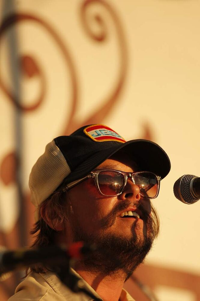 JD Edwards of the JD Edwards band basks in the glow of the setting sun. (John Woods / Winnipeg Free Press)