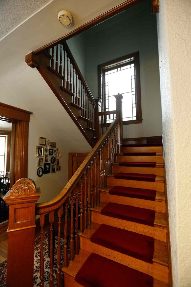 A hand-crafted staircase leads to the upper level.