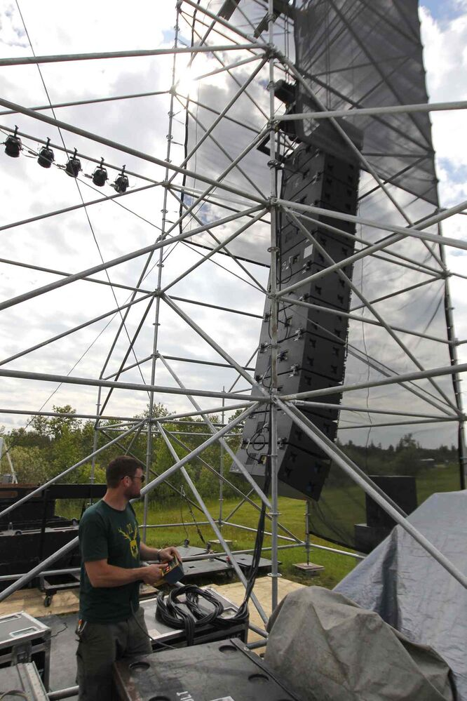 Iain Graham of Sound Art puts up the speakers on Main Stage at the Winnipeg Folk Festival. The popular music festival starts tomorrow.