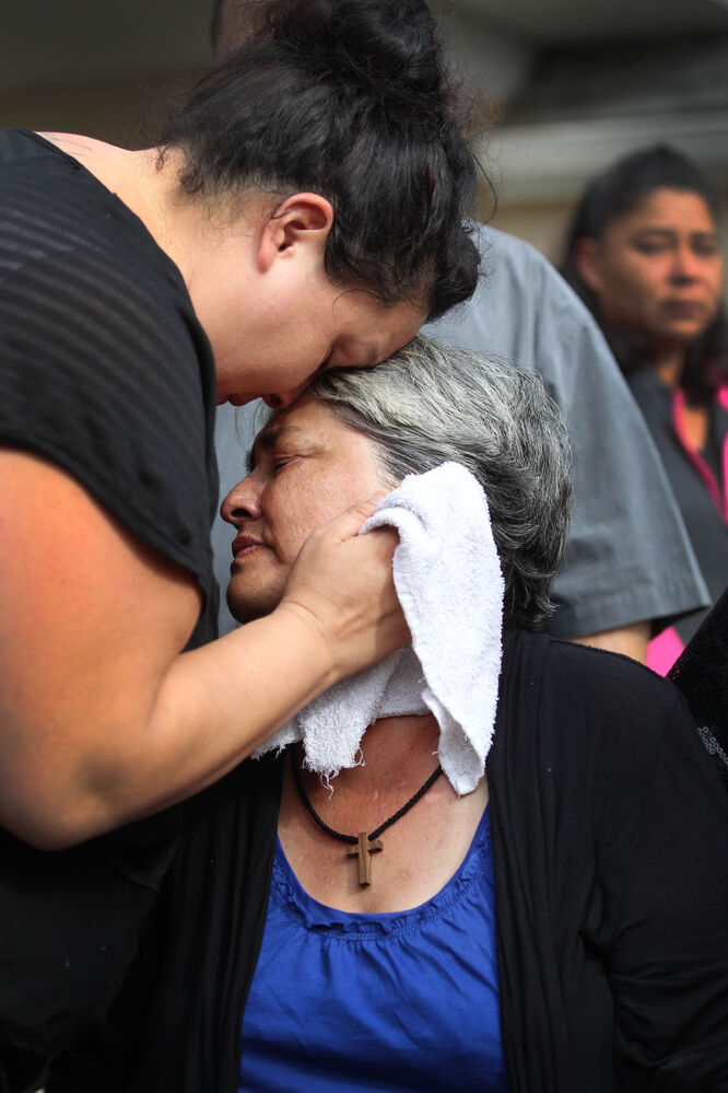 Thelma Favel broke down in tears and was comforted by her daughter Samatha Barto after her deceased grandniece, Tina Fontaine was taken away in a hearse at Sagkeeng First Nation following her funeral Saturday.
