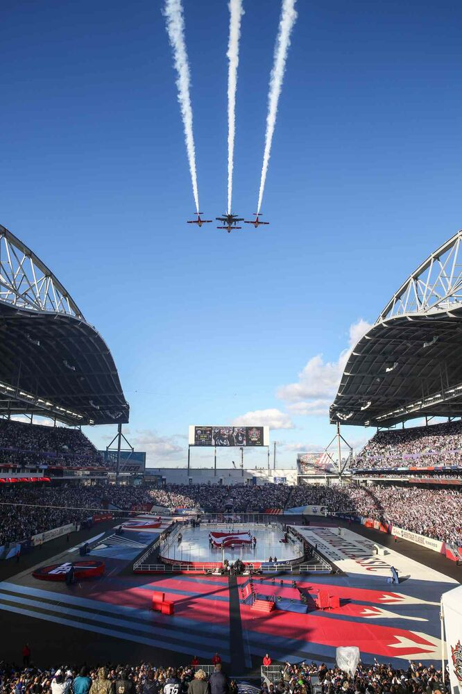 Military jets from 17 Wing fly over the stadium prior to the start of the NHL game between the Winnipeg Jets and the Edmonton Oilers at Investors Group Field on Sunday. (MIKE DEAL / WINNIPEG FREE PRESS)
