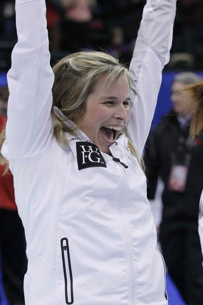 Skip Jennifer Jones celebrates beating Sherry Middaugh in the women's final at the 2013 Roar of the Rings Canadian Olympic Curling Trials. (John Woods / The Canadian Press)