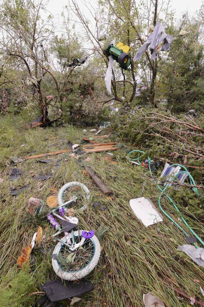 Children's toys, including a toy tractor in a tree, are strewn in a field near a damaged house in Hickman, Neb., Friday, Oct. 4, 2013. (Nati Harnik / The ASsociated Press)