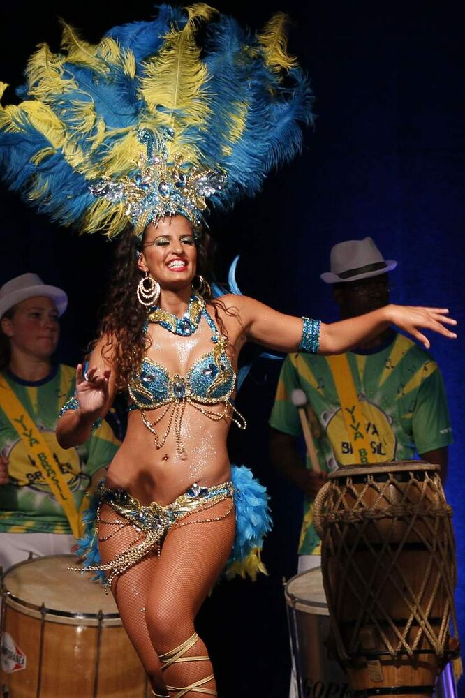 A dancer performs in the Brazilian pavilion.