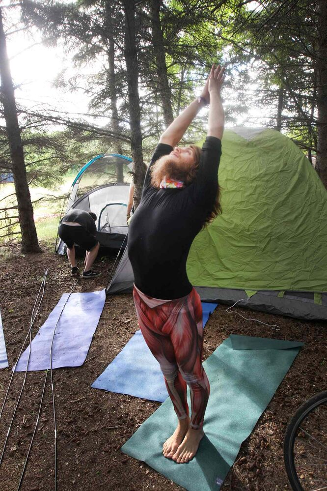 Campers arrive at their campsites to kick off the 2016 Winnipeg Folk Festival at Birds Hill Park. Winnipeg yoga instructor Jitendradaf Lovelife does some moves before setting up his tent. July 5, 2016.