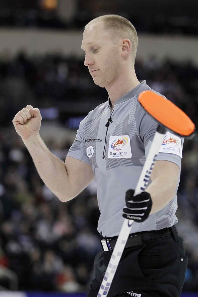 Skip Brad Jacobs fist-pumps after scoring two in the first end during the men's final against John Morris at the 2013 Roar of the Rings Canadian Olympic Curling Trials Sunday.