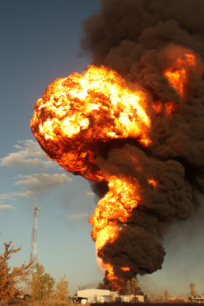 A truck tanker containing 75,000 litres of methanol caught fire and exploded, sending flames 800 metres into the sky.