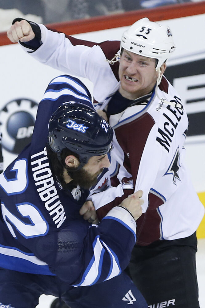 Colorado's Cody McLeod tosses knuckles with the Jets' Chris Thorburn. (JOHN WOODS / WINNIPEG FREE PRESS)