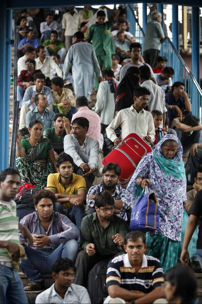 Stranded passengers wait for train services to resume following a power outage in New Delhi, India, Tuesday, July 31, 2012. India's energy crisis cascaded over half the country Tuesday when three of its regional grids collapsed, leaving 620 million people without government-supplied electricity for several hours in one of the world's biggest-ever blackouts. Hundreds of trains stalled across the country and traffic lights went out, causing widespread traffic jams in New Delhi. (AP Photo/Rajesh Kumar Singh) (CP)