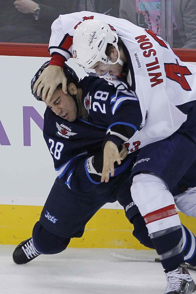 Winnipeg Jets' Patrice Cormier (28) and Washington Capitals' Tom Wilson mix it up during the first period.