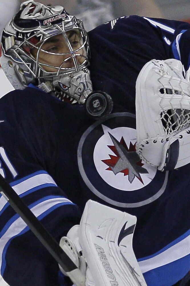Winnipeg Jets goaltender Ondrej Pavelec makes a save against the  Washington Capitals.