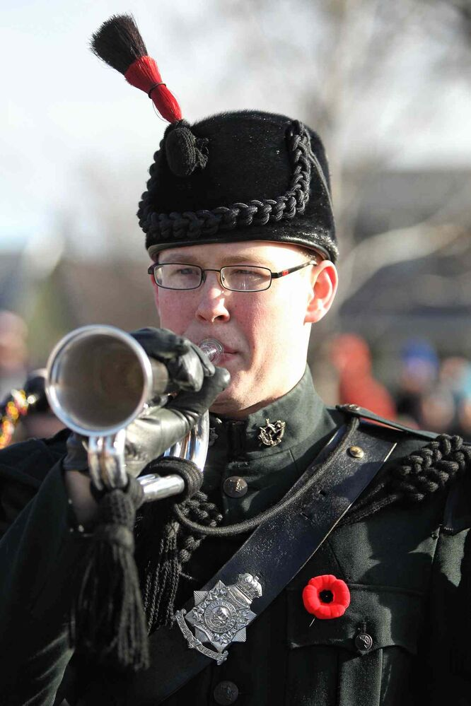 Cpl. Evan Joyal with the Regimental Band of the Royal Winnipeg Rifles plays the bugle during the Remembrance Day ceremony at the Valour Road memorial in Winnipeg Monday, Nov. 11, 2013.