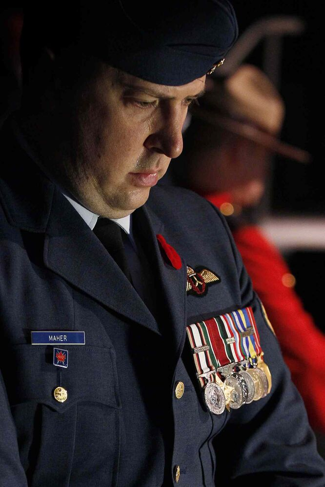 A soldier pauses during the Remembrance Day service at the RBC Convention Centre Winnipeg. (JOHN WOODS / THE CANADIAN PRESS)