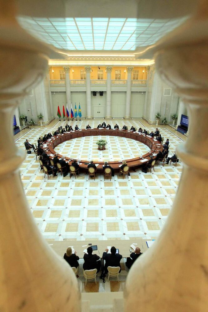 A meeting of Russian Prime Minister Dmitry Medvedev with Belarusian Prime Minister Mikhail Myasnikovich and Kazakhstan's Prime Minister Karim Masimov is held in the Presidential library in St. Petersburg, Russia, Friday, June 15, 2012.