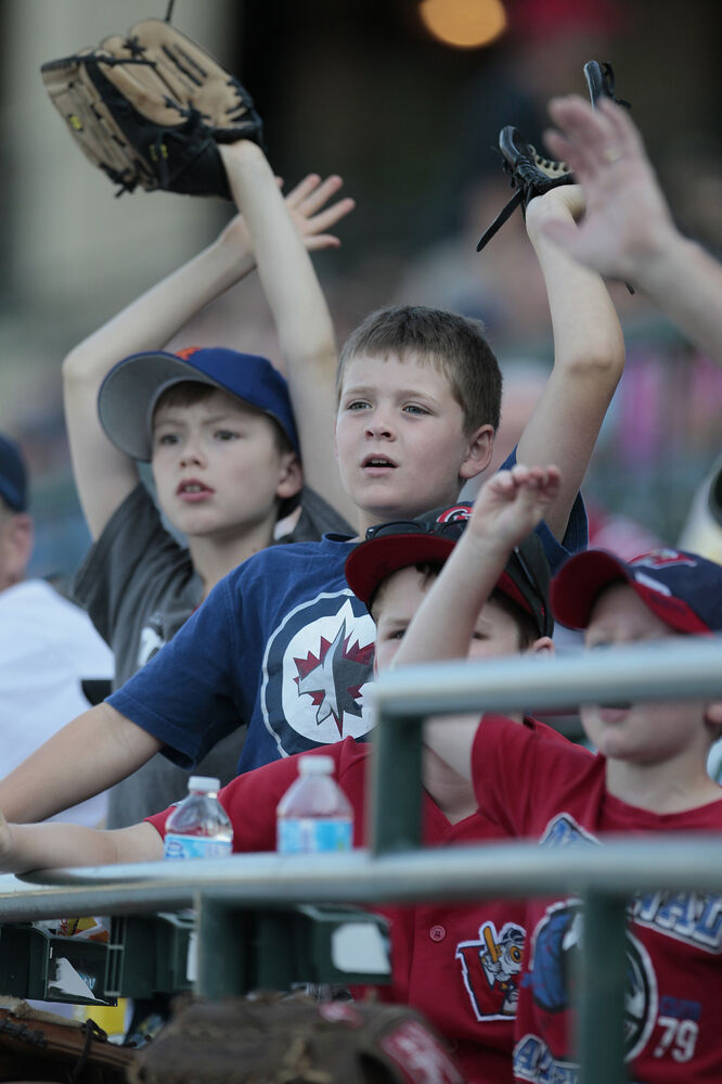Young fans reach up for a popped ball during Monday's All-Star Skills Competition. (John Woods / Winnipeg Free Press)