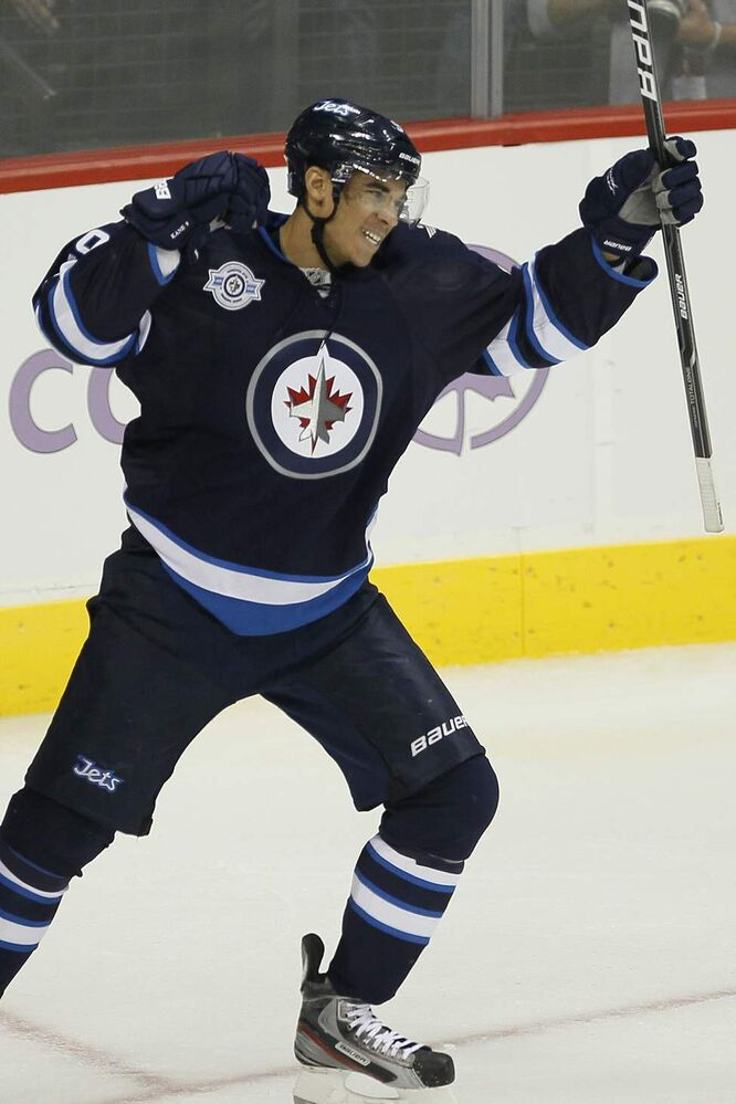 Winnipeg Jets forward Evander Kane (9) celebrates his goal against goalie Brian Boucher (33) and the Carolina Hurricanes in second period action at MTS Centre in Winnipeg Saturday, October 22, 2011. (John Woods/Winnipeg Free Press)