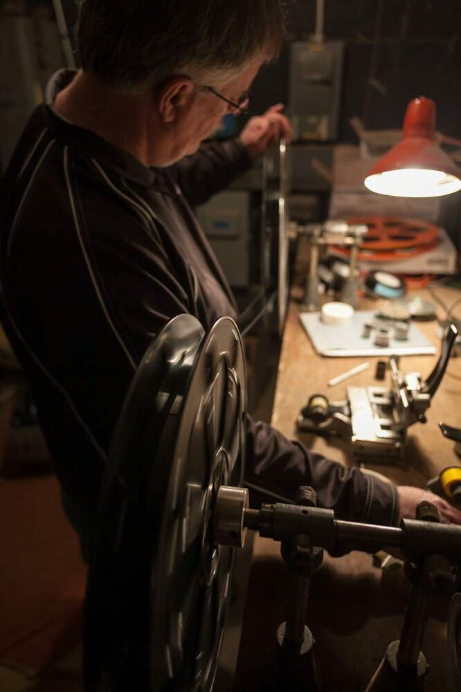 Terry Nelson splices film in the projection room at the Stardust Drive-In theatre in Morden. (Melissa Tait / Winnipeg Free Press)