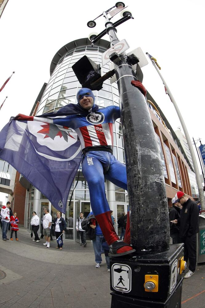 Ryan Gilmour, a hard-core Jets fan, outside MTS Centre. (Trevor Hagan / Winnipeg Free Press)