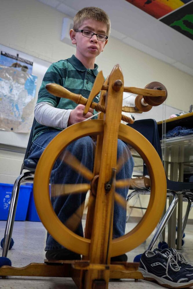 Michael Elias, 12, spins yarn on one of the class's four spinning wheels. (MIKE DEAL / WINNIPEG FREE PRESS)