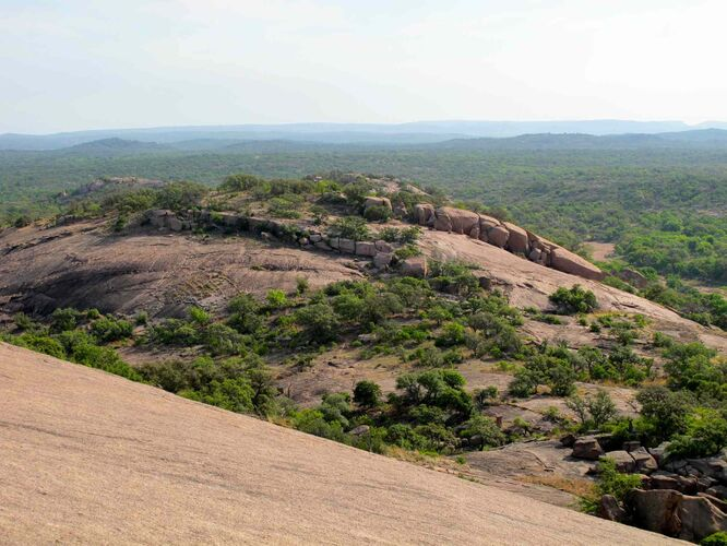View of Hill Country from the 152-metre pink granite dome at Enchanted Rock State Natural Area in Central Texas. -