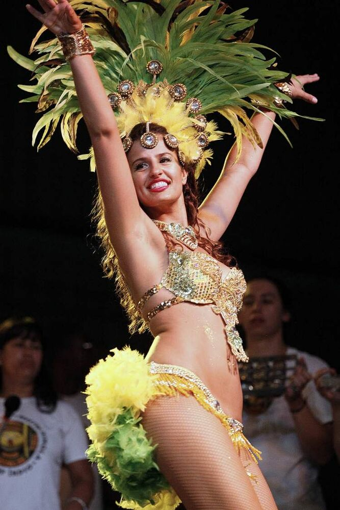 A dancer performs at the Brazilian Pavilion Sunday, August 5, 2012.