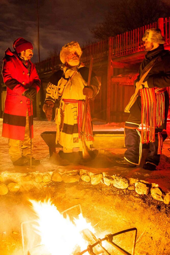 "Barney Morin, Ron ""Pinky"" Colomy, and Curt Lavalle warm up by the fire at Festival du Voyageur on Friday night. (GREG GALLINGER / WINNIPEG FREE PRESS)"