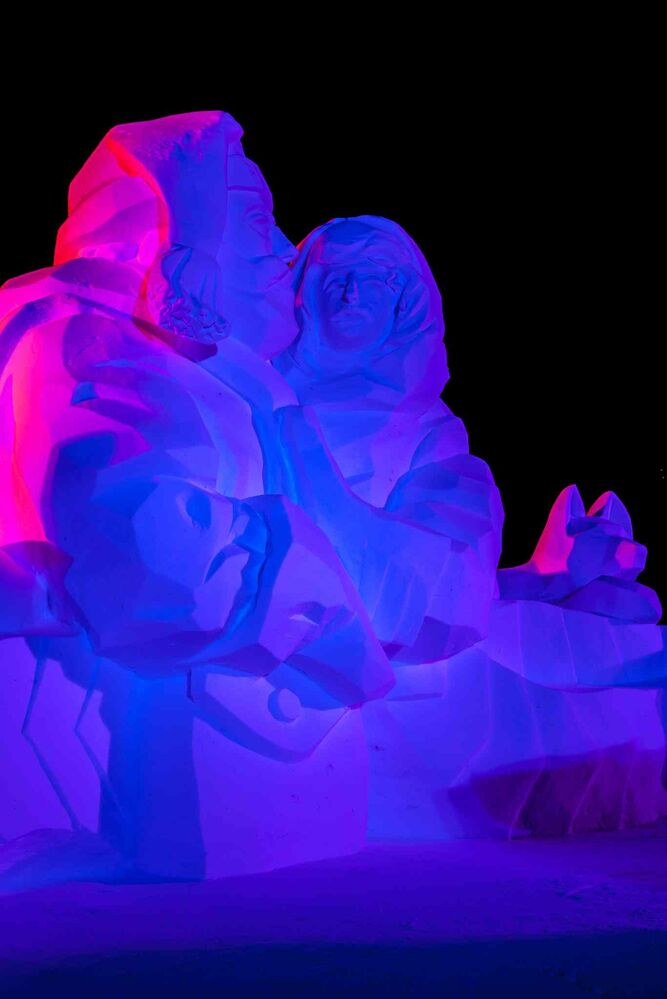 A snow sculpture is illuminated on the grounds of Fort Gibraltar on opening night of the Festival du Voyageur.