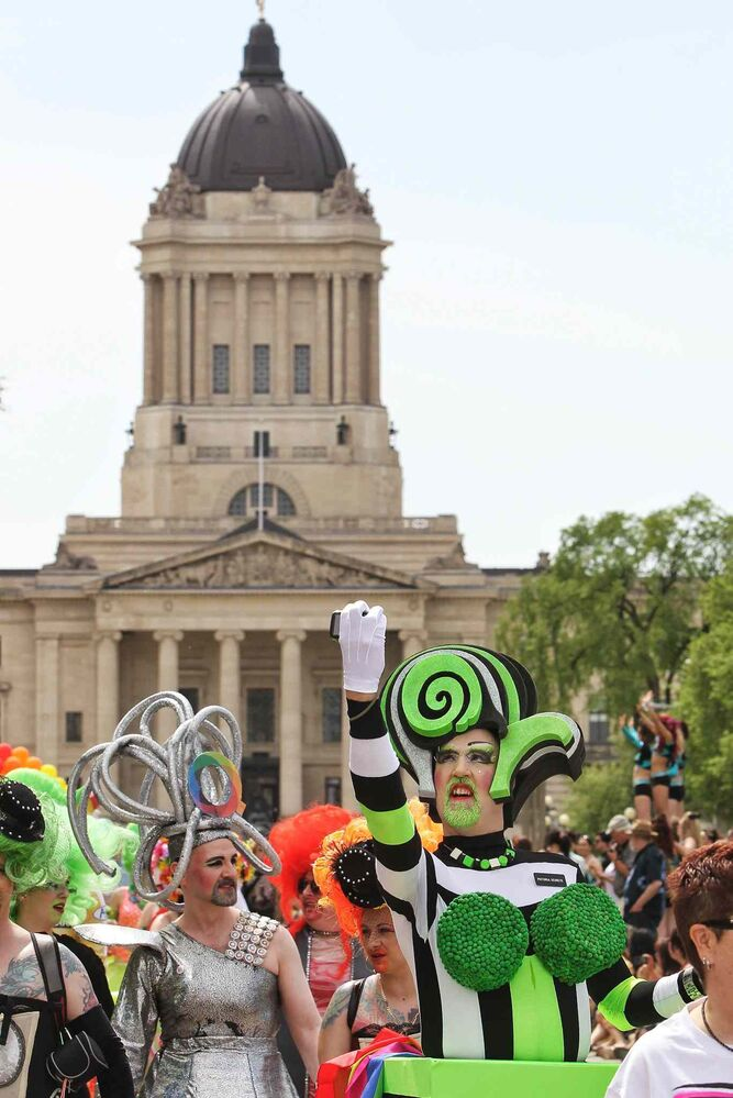 A participant shoots a selfie in the 2014 Pride Parade. (Mike Deal / Winnipeg Free Press)