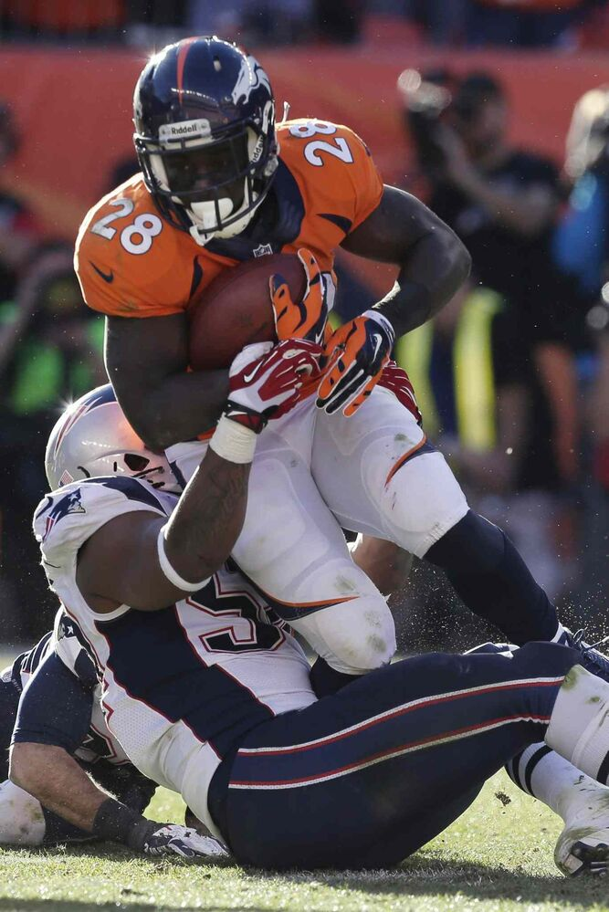 Broncos running back Montee Ball is stopped by Patriots outside linebacker Dont'a Hightower. (Julie Jacobson / The Associated Press)