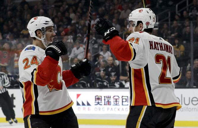 <p>Calgary Flames defenseman Travis Hamonic, left, has created a new charitable initiative called