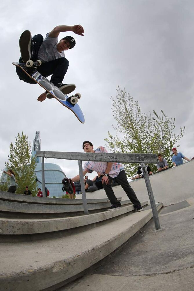 The Canadian Museum for Human Rights can be seen in the background as a participant in the Skate4Cancer skateboarding competition. (TREVOR HAGAN / WINNIPEG FREE PRESS)