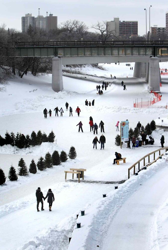 Winnipegers made their way down to the river to enjoy the newly opened Red River Mutual Trail on the Assiniboine River at the Forks Saturday afternoon. Officials have said the river trail's length will keep growing as the winter goes on. (Ruth Bonneville / Winnipeg Free Press)