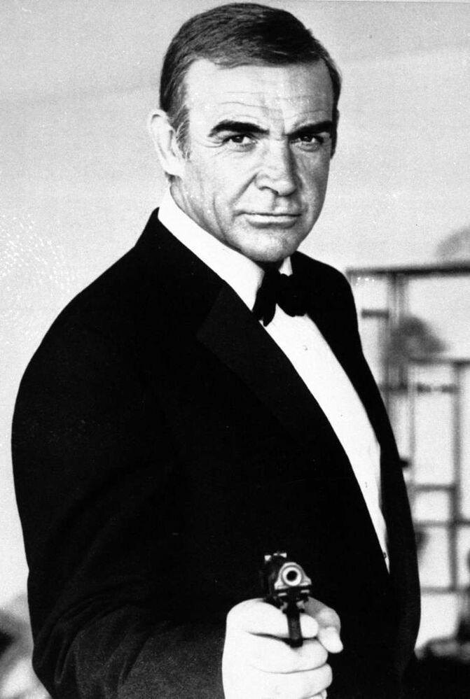Sean Connery as James Bond in Never Say Never Again. The film, a 1983 remake of Thunderball, has its ironic title because it brought Connery back as Bond after a 12-year hiatus.