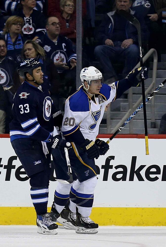 St. Louis Blues forward Alexander Steen (20) celebrates in front of Winnipeg Jets defenceman Dustin Byfuglien after scoring a goal during the second period of an NHL game against at the MTS Centre in Winnipeg Tuesday, Dec. 10, 2013.