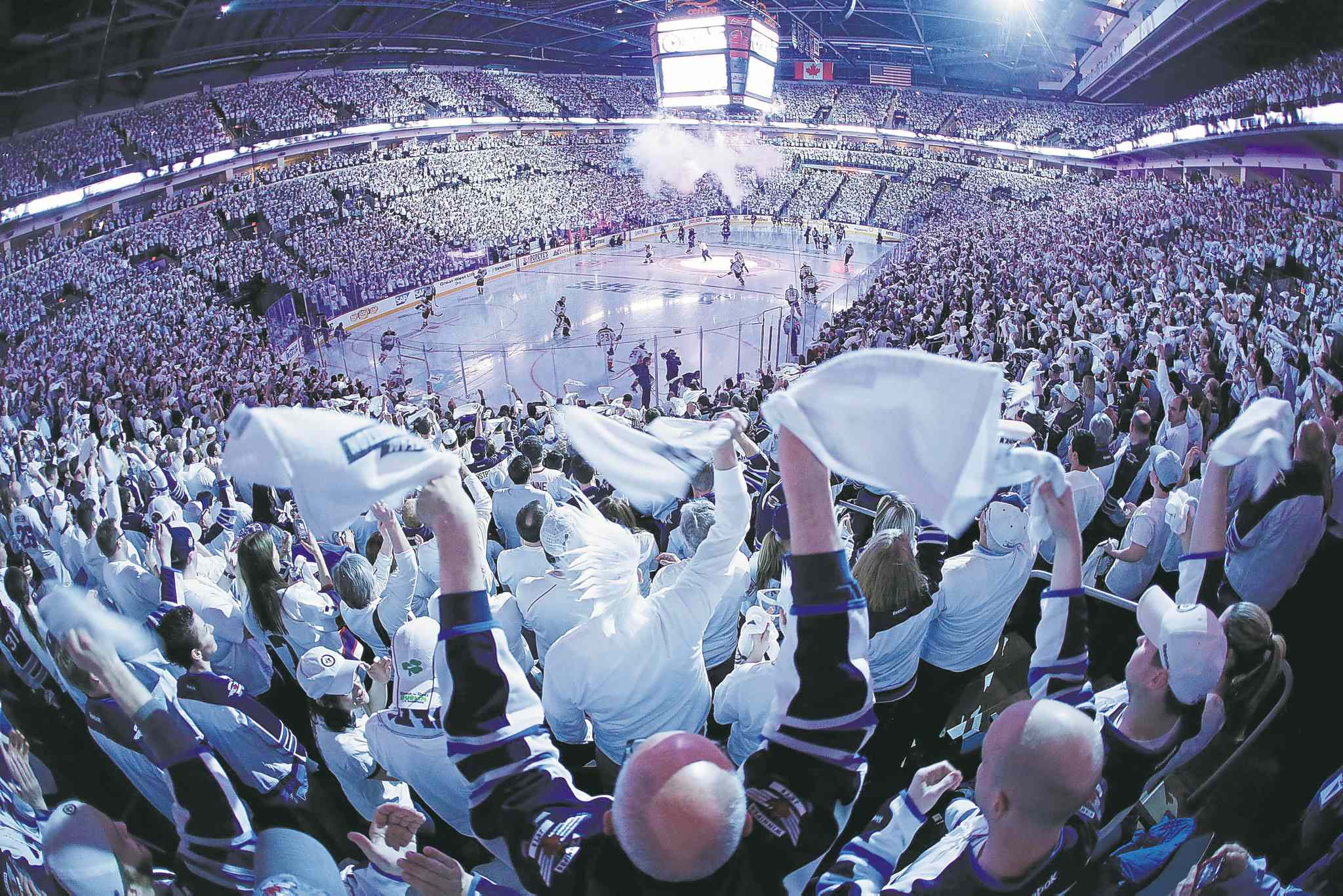 Winnipeg fans celebrate the start of game four of the NHL playoffs between the Winnipeg Jets and the Anaheim Ducks in Winnipeg on Wednesday, April 22, 2015.