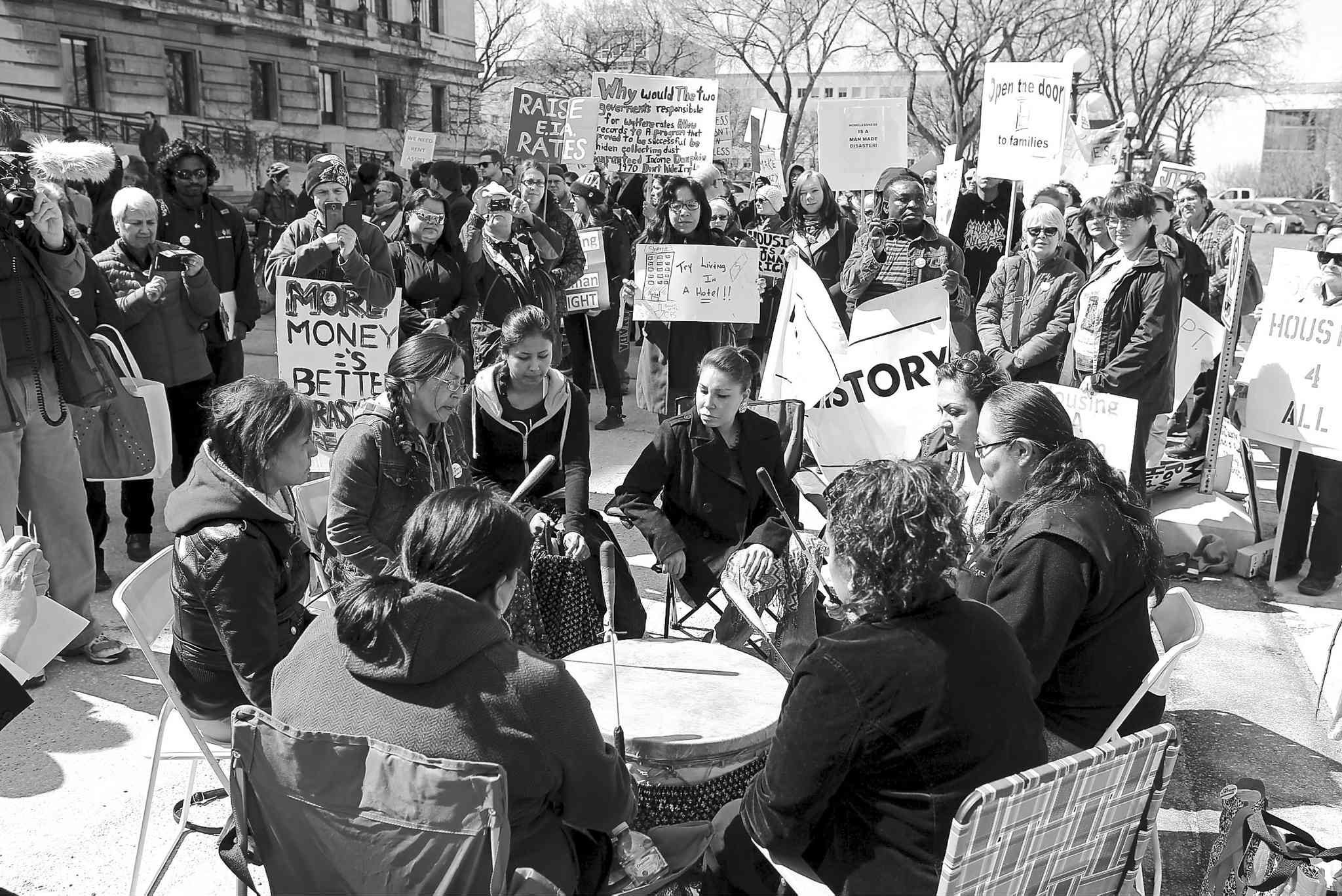 Anti-poverty  advocates gathered near the steps of the Manitoba  legislature  Thursday to demand the  Manitoba  government make poverty-reduction measures a priority in its 2015 provincial budget.