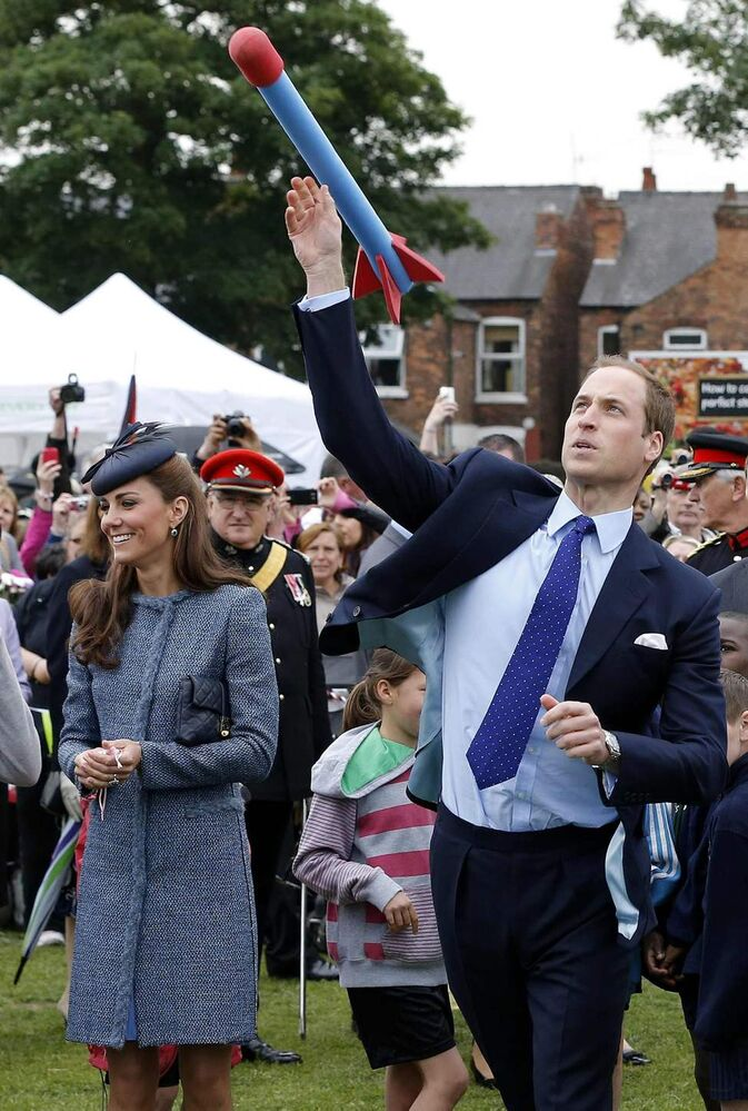 Britain's Prince William, right, throws a foam javelin as his wife Kate, Duchess of Cambridge, looks on at a children's sports event, during her visit to Vernon Park in Nottingham, central England, Wednesday, June 13, 2012.  (Phil Noble / The Associated Press / Pool)