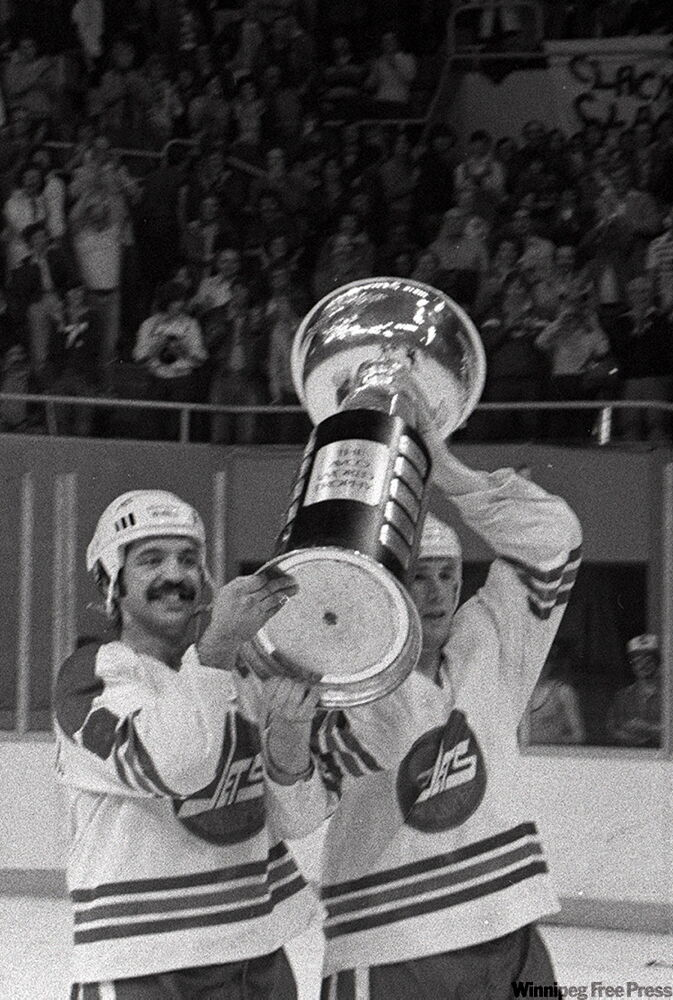 Terry Ruskowski  and teammate celebrate Jets third Avco Cup victory.