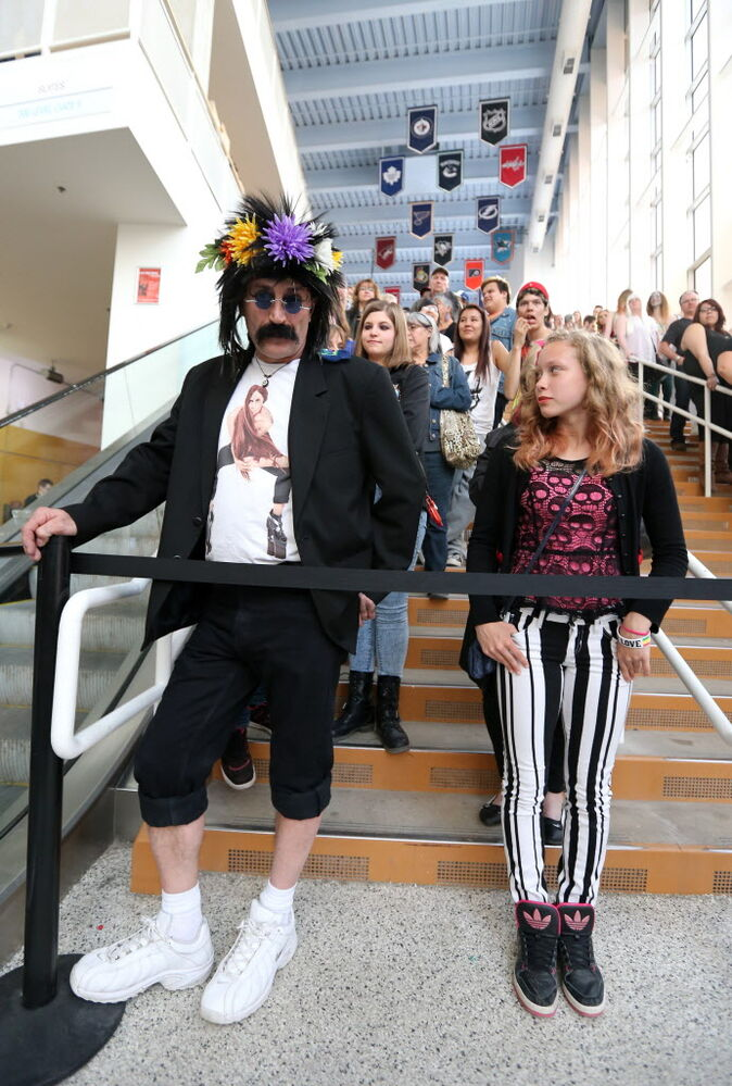 Ray Okapiac (left) and Kira Kirzinger, 13, wait for the doors to open at the MTS Centre for the Lady Gaga concert on Thursday evening. (Jason Halstead / Winnipeg Free Press)
