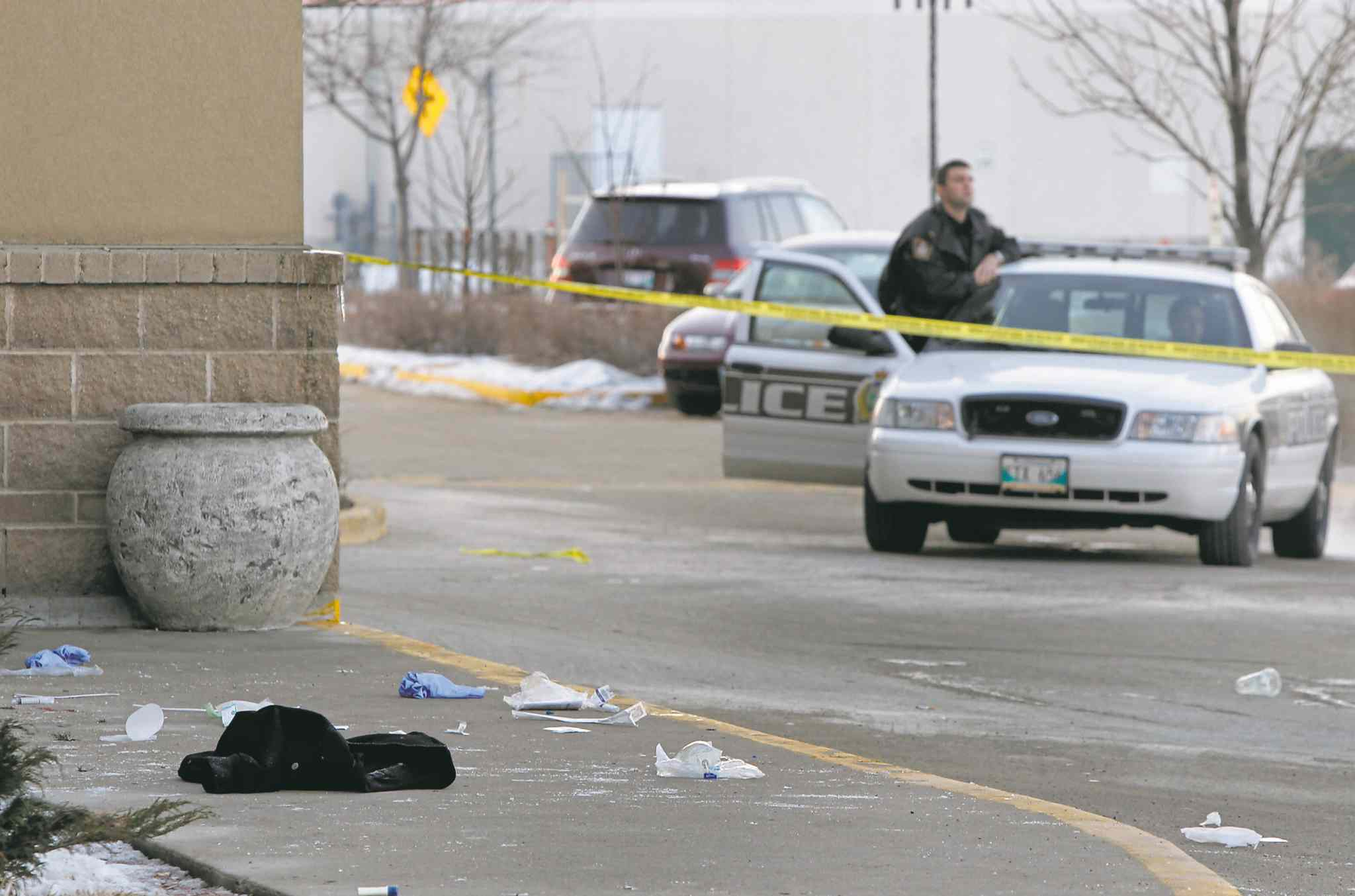 Police tape surrounds where Wahbishkanacot 'Eli' Mandamin died outside Canad Inns Polo Park in February 2012.