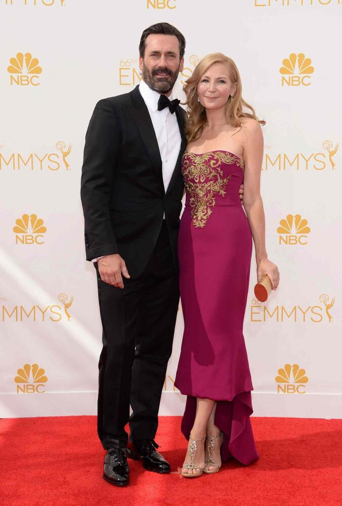 Mad Men's Jon Hamm, left, and his wife, actor Jennifer Westfeldt, arrive at the 66th Primetime Emmy Awards Monday. (Evan Agostini/Invision for the Television Academy/AP Images)
