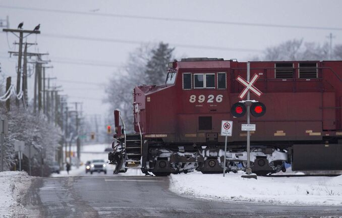 "Some 112 loaded grain cars and a mid-train locomotive, ""rolled uncontrolled for almost a mile,"" speeding through a flashing-light crossing as well as one that uses standard railway crossing signs. (Darryl Dyck / The Canadian Press files)</p>"