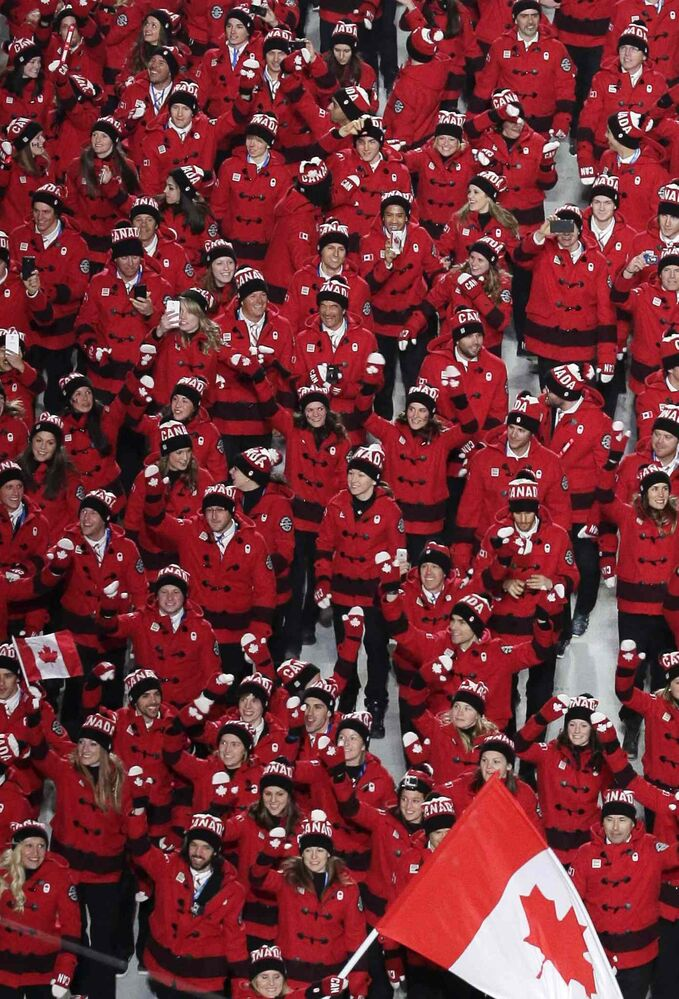 Team Canada enters the arena during the opening ceremony of the 2014 Winter Olympics in Sochi, Russia, Friday, Feb. 7, 2014. (AP Photo/Charlie Riedel)