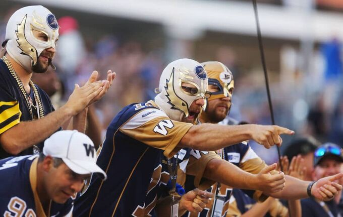 Fans cheer on the Winnipeg Blue Bombers at the Investors Group Field in Winnipeg.